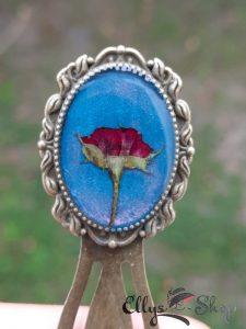 Semn de carte unicat boboc trandafir pe fond turcoaz si roz sidefat
